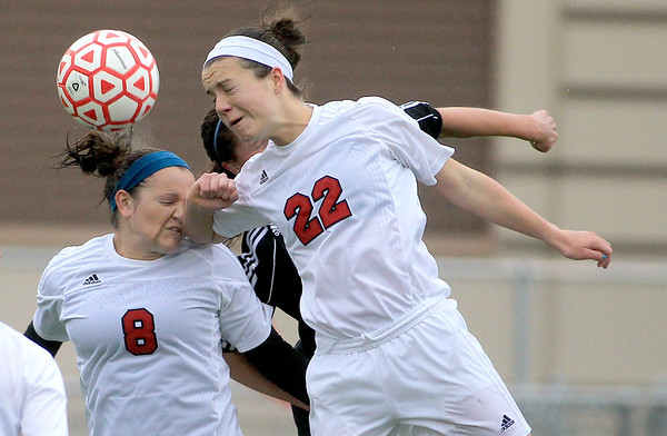 Batavia's Brittany Wahlen (8) and Grace Andrews (22) head the ball during their home game against Geneva Tuesday.