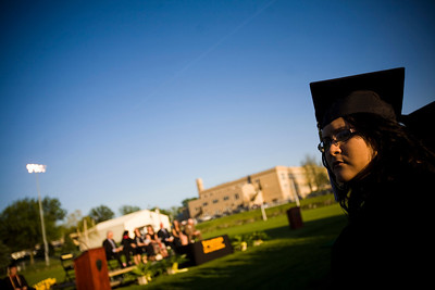 Lance Booth - lbooth@shawmedia.com Alicia Flores, of Harvard, watches during the Harvard High School 2012 Graduation Commencement on Tuesday, May 22, 2012.
