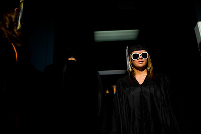 Lance Booth - lbooth@shawmedia.com Patience Esunis, 17, of Harvard, waits before the start of the Harvard High School 2012 Graduation Commencement on Tuesday, May 22, 2012.