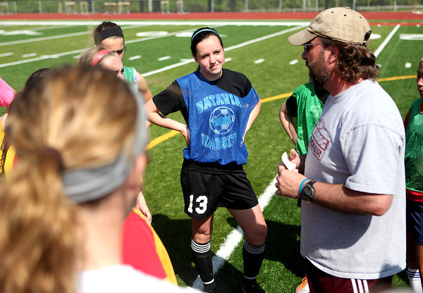 Batavia soccer player Jessica Milaneses listens to coach Mark Gianfrancesco during practice with her team at Mooseheart Monday afternoon.