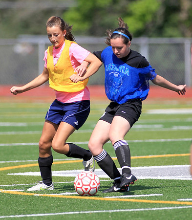 Batavia soccer player Jessica Milaneses (right) practices with her team, including Meagan Reinecke(left), on the artificial turf at Mooseheart Monday afternoon.