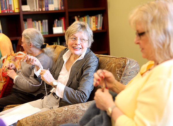 Edie Hughes (left) and Jan Crooch share a laugh while knitting in the library of the new LivingWell Cancer Resource Center in Geneva Tuesday. The center opened May 7.