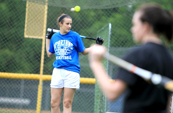 St. Francis pitcher Maggie Remus of St. Charles talks with her teammates during batting practice at the school Monday.