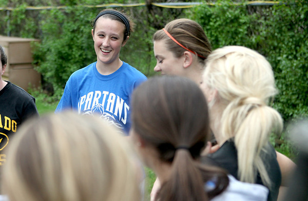 St. Francis pitcher Maggie Remus of St. Charles talks with her teammates following batting practice at the school Monday.
