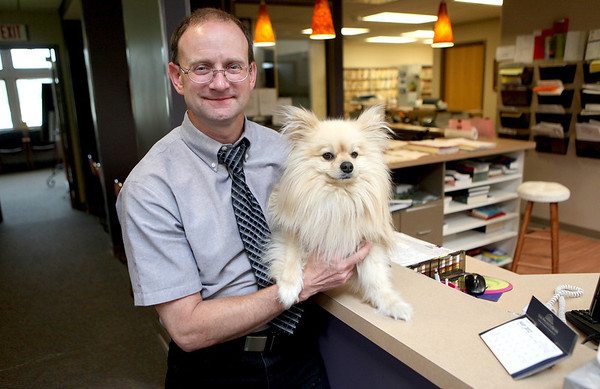 Tank, a blonde Pomeranian, gave his owners Mark and Linn Lewis a scare on Sunday when he disappeared from their boat while cruising the Chicago River. Mark Lewis, pictured here, turned to the Chicago media for help in finding Tank. They were reunited late Monday night.