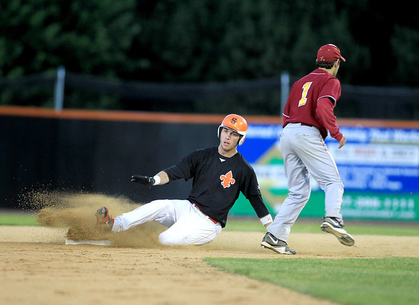St. Charles East's Luke Ludke slides safely into second during their sectional semifinal game against Schaumburg Wednesday.