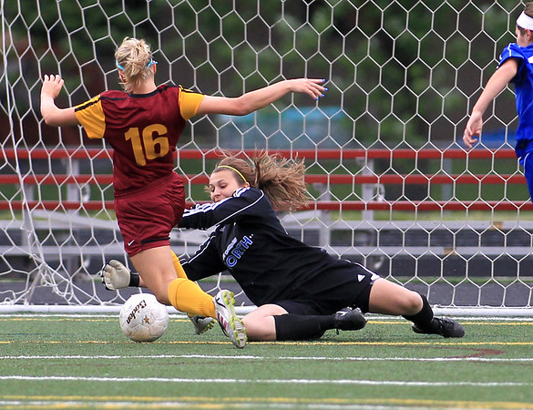 St. Charles North goalkeeper Carly Dietrich makes a save during their Schaumburg Sectional win in penalty kicks over Schaumburg Friday night.