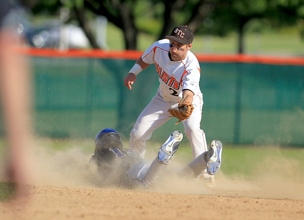 St. Charles East's Nicholas Erickson fails to get St. Charles North's Kevin Delisi out at second during their game at East Tuesday.