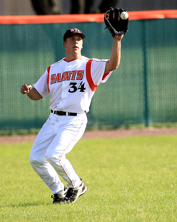 St. Charles East's Joe Hoscheit makes a catch in left field during their home game against St. Charles North Tuesday.