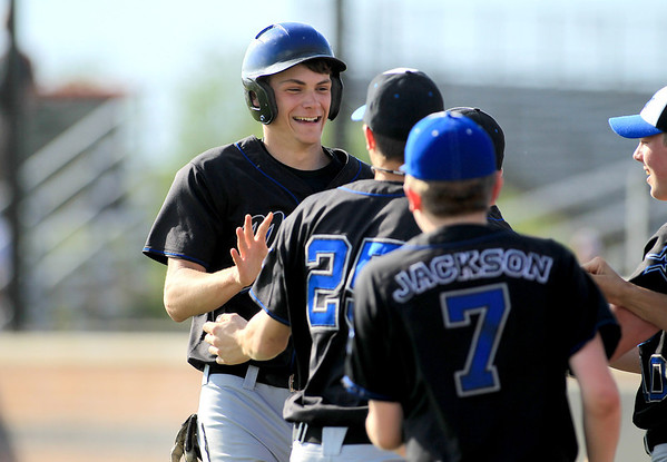 Adam Delisi of St. Charles North celebrates a run with his team during their game at St. Charles East Tuesday.