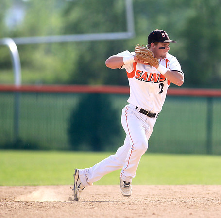 St. Charles East's Nicholas Erickson throws to first during their home game against St. Charles North Tuesday.