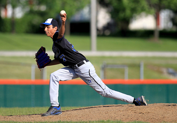 St. Charles North's Ankur Shah pitches against St. Charles East Tuesday at East.