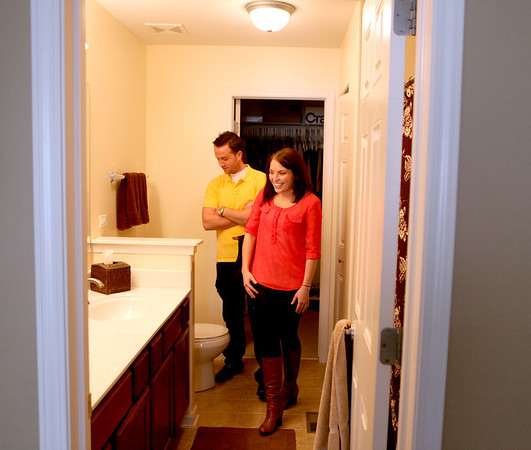 Phil and Erin Hope tour the home they are buying through a short sale in Batavia.
