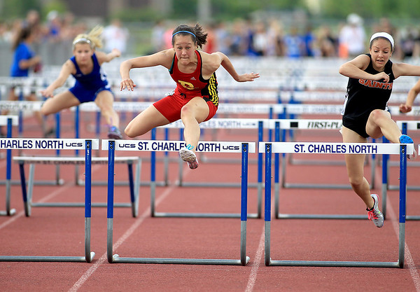 Hailey Clabough (center) of Batavia wins the 100-meter hurdles during the Upstate Eight River Division Girls Track and Field Championships at St. Charles North Thursday.