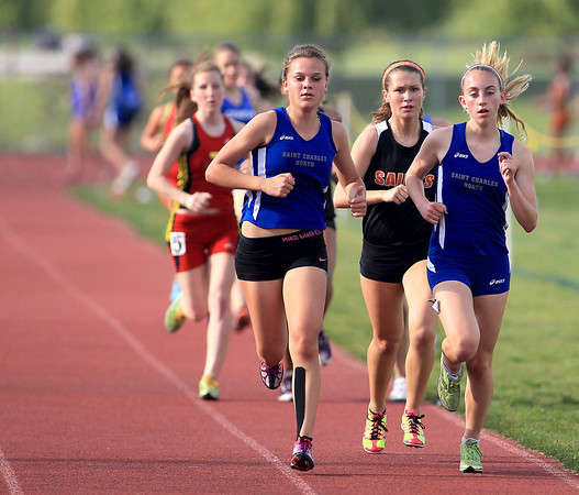 St. Charles North's Sydney Stuenkel (left) and Kaylee Wessel lead the pack in the 3200-meter run during the Upstate Eight River Division Girls Track and Field Championships at St. Charles North Thursday. Stuenkel won the event.