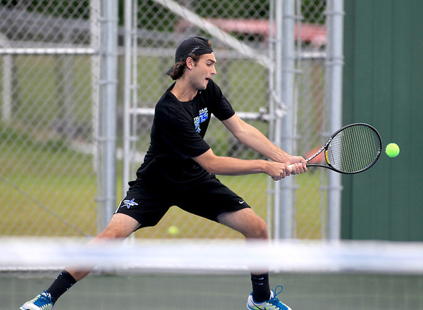 St. Charles North's Danny Oakes returns the ball during No. 1 doubles play with partner Dom Amalraj (not pictured) against St. Charles East's Connor Davis and Mike Muir Tuesday.