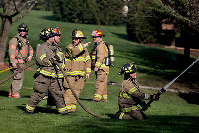 Sarah Nader -snader@shawmedia.com  Two firefighters are being treated for injuries after four houses caught on fire Wednesday, May 1, 2013 in a Crystal Lake subdivision. One house is still on fire on the 3200 block of Carrington Drive in Crystal Lake. Firefighters are proceeding with caution because of a ruptured gas line.