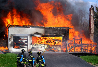 Sarah Nader - snader@shawmedia.com Firefighters watch as a home burns at 3217 Carrington Drive in Crystal Lake on Wednesday, May 1, 2013. The fire originated sometime after 3:30 p.m. and quickly spread to three other homes.