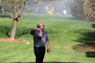 Sarah Nader -snader@shawmedia.com  Rick Noe of Crystal Lake watches as put out a fire at his house Wednesday, May 1, 2013 in a Crystal Lake subdivision.