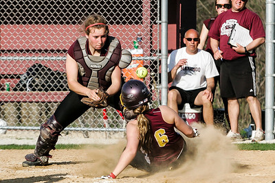 Lathan Goumas - lgoumas@shawmedia.com Samantha Dahlen of Richmond High School slides safely into home after a missed tag from Marengo High School catcher Taylor Carlson during a game in Richmond, Ill. on Wednesday, May 01, 2013. Marengo defeated Richmond-Burton 14-7.