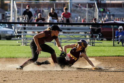 Lathan Goumas - lgoumas@shawmedia.com Shaw Karsten of Marengo High School unsuccessfully attempts to tag Samantha Dahlen of Richmond-Burton High School during a game in Richmond, Ill. on Wednesday, May 01, 2013. Marengo defeated Richmond-Burton 14-7.