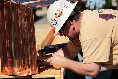 Kyle Grillot - kgrillot@shawmedia.com   Conrad Roofing of Illinois employee Michael Bosak solders sheets of copper together Tuesday outside St. John-Baptist Catholic Church. The church is under renovations as Conrad Roofing of Illinois installs a copper roof on the building. This project is estimated to take up to a year for completion.
