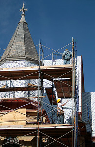 Kyle Grillot - kgrillot@shawmedia.com   Conrad Roofing of Illinois employees John Bartosak (top) and John Ramnski work on the scaffolding around St. John-Baptist Catholic Church. The church is under renovations as Conrad Roofing of Illinois installs a copper roof on the building. This project is estimated to take up to a year for completion.