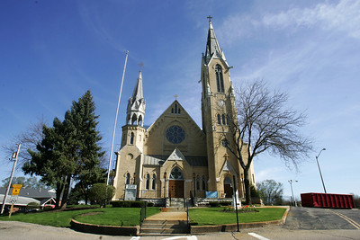 Kyle Grillot - kgrillot@shawmedia.com   St. John-Baptist Catholic Church is under renovations as Conrad Roofing of Illinois installs a copper roof on the building. This project is estimated to take up to a year for completion.
