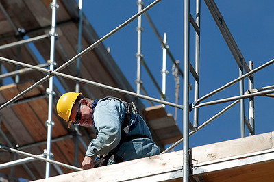 Kyle Grillot - kgrillot@shawmedia.com   Conrad Roofing of Illinois employee John Bartosak works on the scaffolding around St. John-Baptist Catholic Church. The church is under renovations as Conrad Roofing of Illinois installs a copper roof on the building. This project is estimated to take up to a year for completion.
