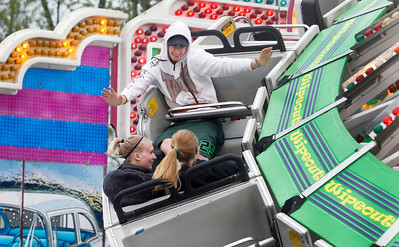 Candace H. Johnson Heather Heck, 19, Ashley Hlad, 20, both of McHenry, and Brandon Rouley, 19, of Twin Lakes, Wisc., enjoy the Wipeout ride during the Moose Fest Carnival at the McHenry Moose Lodge 691 in Johnsburg.