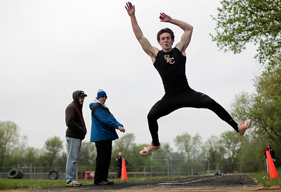 Kyle Grillot - kgrillot@shawmedia.com   Crystal Lake Central senior Isaiah Mosher competes in the long jump event during the Fox Valley Conference boys track Friday at Cary-Grove High School.