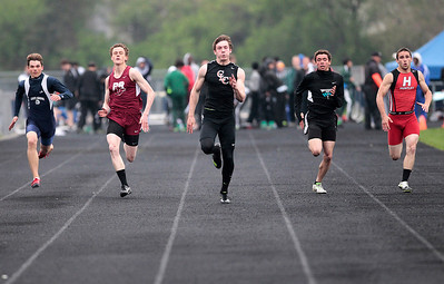 Kyle Grillot - kgrillot@shawmedia.com   Crystal Lake Central senior Isaiah Mosher (center) leads the men's 100-meter dash semi-finals during the Fox Valley Conference boys track Friday at Cary-Grove High School.