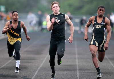 Kyle Grillot - kgrillot@shawmedia.com   Jocobs sophomore Walker Josh, Crystal Lake Central senior Isaiah Mosher, and Grayslake North sophomore Titus Booker compete during the men's 100-meter dash finals during the Fox Valley Conference boys track Friday at Cary-Grove High School.