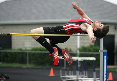Kyle Grillot - kgrillot@shawmedia.com   Huntley junior seth Raymer competes in the high jump final event during the Fox Valley Conference boys track meet Friday at Cary-Grove High School.