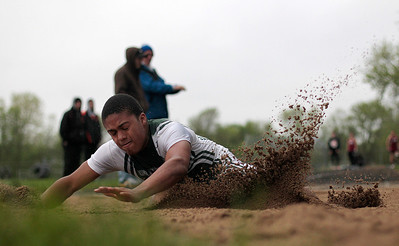 Kyle Grillot - kgrillot@shawmedia.com   Grayslake Central junior Kacey Adams lands after competing in the long jump event during the Fox Valley Conference boys track Friday at Cary-Grove High School.