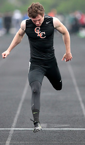 Kyle Grillot - kgrillot@shawmedia.com   Crystal Lake Central senior Isaiah Mosher crosses the finish line as he wins the the men's 100-meter dash semi-finals during the Fox Valley Conference boys track Friday at Cary-Grove High School.