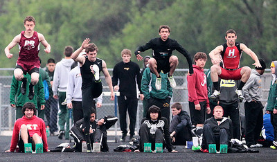 Kyle Grillot - kgrillot@shawmedia.com   Competitors prepare themselves for the men's 100-meter dash semi-finals during the Fox Valley Conference boys track Friday at Cary-Grove High School.