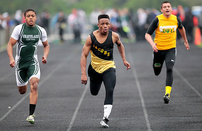 Kyle Grillot - kgrillot@shawmedia.com   Jacobs sophomore Walker Josh (center) competes with Grayslake Central junior Kacey Adams (left) and Crystal Lake South senior Zach Balousek during the men's 100-meter dash semi-finals during the Fox Valley Conference boys track Friday at Cary-Grove High School.