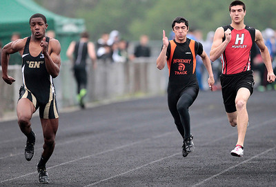 Kyle Grillot - kgrillot@shawmedia.com   Grayslake North sophomore Titus Booker, McHenry sophomore Italo Roche and Huntley senior Mike Dollar compete in the men's 100-meter dash semi-finals during the Fox Valley Conference boys track Friday at Cary-Grove High School.