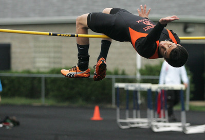 Kyle Grillot - kgrillot@shawmedia.com   McHenry senior Gilbert Matias competes in the high jump event during the Fox Valley Conference boys track meet Friday at Cary-Grove High School.