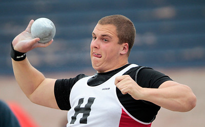 Kyle Grillot - kgrillot@shawmedia.com   Huntley senior Justin Herbert competes in the shot put event during the Fox Valley Conference boys track meet Friday at Cary-Grove High School.