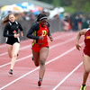Leah Narup of Batavia (center) runs the 200-meter dash during the West Aurora Girls Track and Field Sectional Thursday.