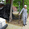 Cliff McIlvaine talks with reporters outside his St. Charles home Thursday. McIlvaineCliff McIlvaine talks with reporters outside his St. Charles home Thursday. A judge last week ruled the city of St. Charles can mitigate safety hazards at McIlvaine's. He started the project at 605 Prairie St. in 1975.