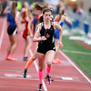 Toree Scull of St. Charles East starts the anchor leg of the 4x800 relay during the West Aurora Girls Track and Field Sectional Thursday.