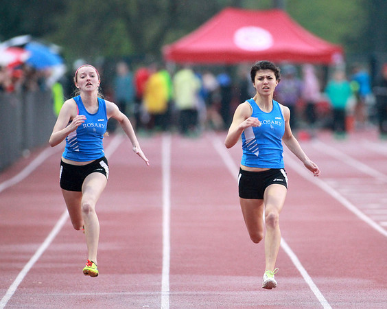 Rosary's Krystina Perillo (left) and Stephanie McDermot (right) run the 100-meter dash finals during the West Aurora Girls Track and Field Sectional Thursday.