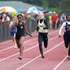 Britney Williams of St. Charles East takes the lead as the anchor leg of the 4x100 relay during the West Aurora Girls Track and Field Sectional Thursday.
