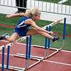 Brittany Kostrzeski of St. Charles North runs in the preliminaries of the 100-meter hurdles during the West Aurora Girls Track and Field Sectional Thursday.