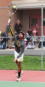 Kyle Grillot - kgrillot@shawmedia.com   Jacobs Kailash Panchapakesan serves the ball during the Fox Valley Conference tennis match Saturday at Crystal Lake Central.