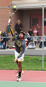 Kyle Grillot - kgrillot@shawmedia.com   Jacobs Kailash Panchapakesan serves the ball during the Fox Valley Conference tennis match Saturday at Crystal Lake Central.