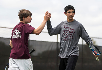 Kyle Grillot - kgrillot@shawmedia.com   Prairie Ridge's Brad Henning and Bij Heydari celebrate a scored point during the Fox Valley Conference tennis match Saturday at Crystal Lake Central.